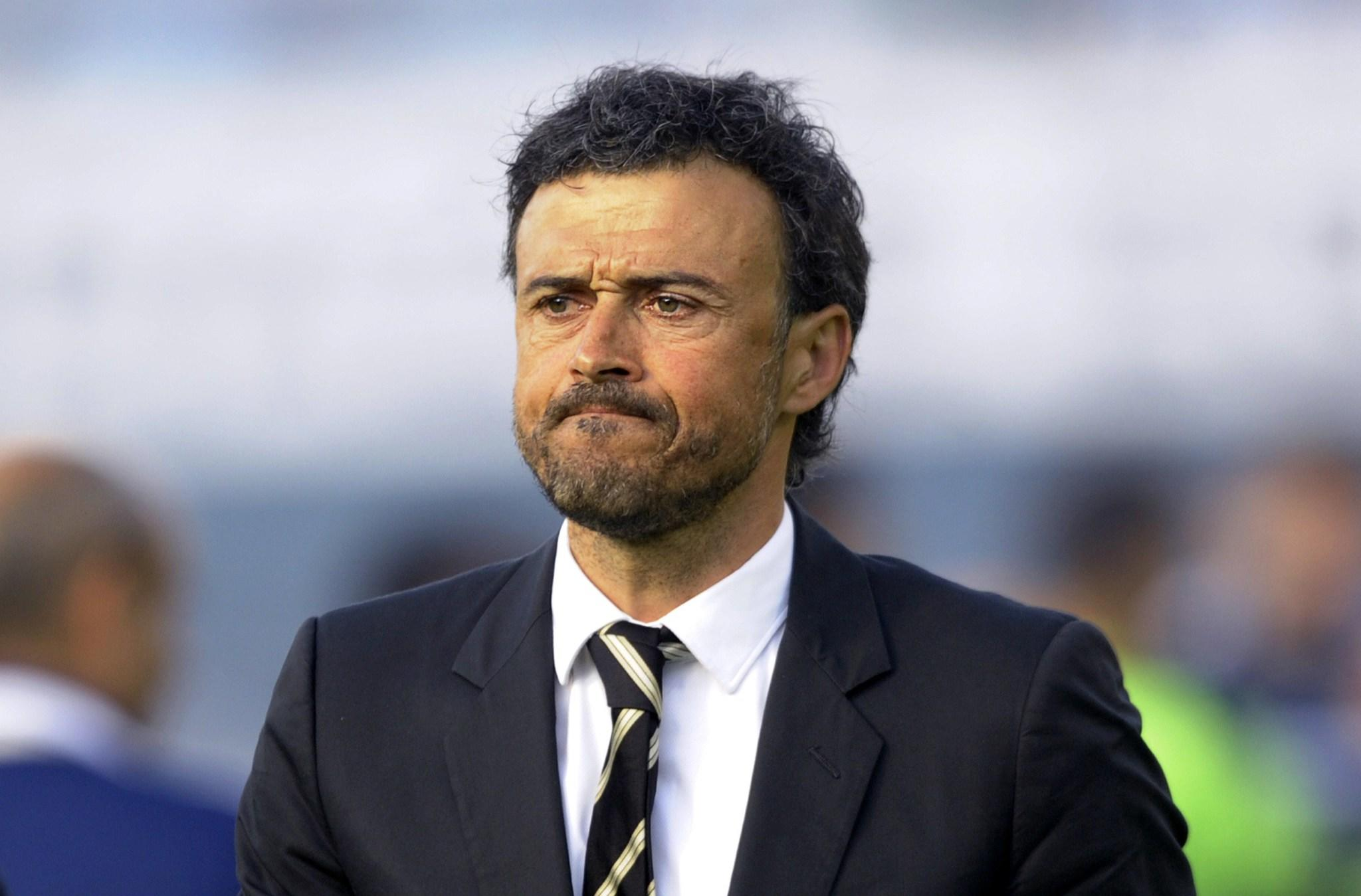 (FILES) A file picture taken on May 11, 2014 shows Celta's coach Luis Enrique leaving the pitch at the end of the Spanish league football match RC Celta de Vigo vs Real Madrid CF at the Balaidos stadium in Vigo. Barcelona name Luis Enrique as new coach on May 19, 2014. Just two days after ending a first season in six years without a major trophy, Barcelona have turned to one of their own in former captain Luis Enrique to restore the glory days at the Camp Nou. AFP PHOTO/ MIGUEL RIOPAMIGUEL RIOPA/AFP/Getty Images ORG XMIT: