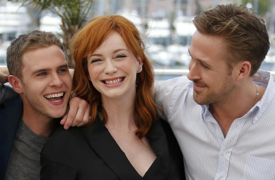 """Director Ryan Gosling (R), cast members Christina Hendricks (C) and Iain De Caestecker (L) pose during a photocall for the film """"Lost River"""" in competition for the category """"Un Certain Regard"""" at the 67th Cannes Film Festival."""