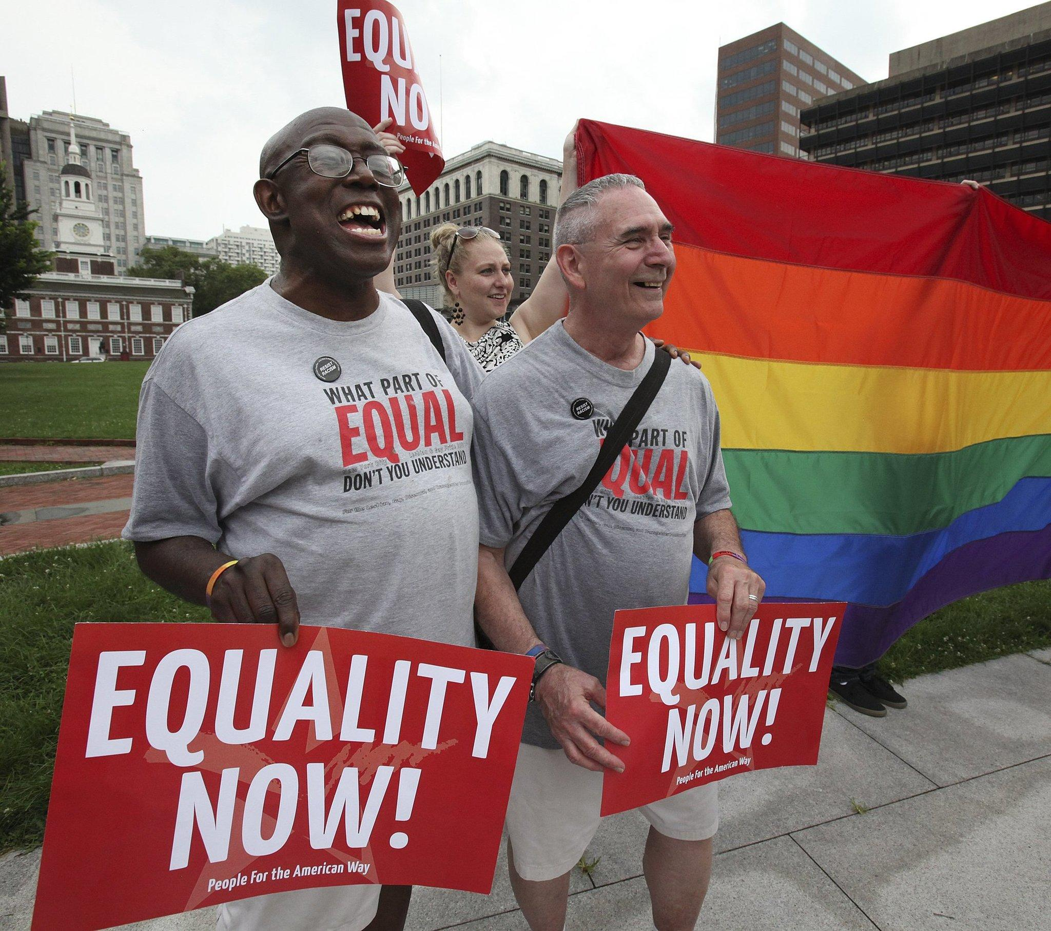 Stevie Martin-Chester, left, with his husband Arthur Martin-Chester, attend a rally in Philadelphia in support of gay marriage.