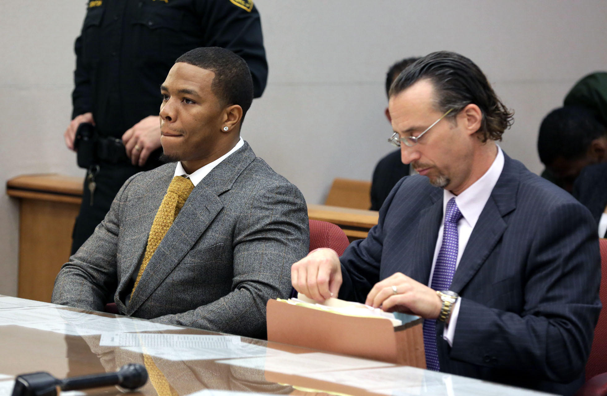 Baltimore Ravens player Ray Rice, left, and lawyer Mike Diamondstein sit in the Atlantic County court house in Mays Landing, Thursday May 1, 2014, for his arraignment. Rice faces assault charges for the alleged assault at Revel in Atlantic City on his now wife.