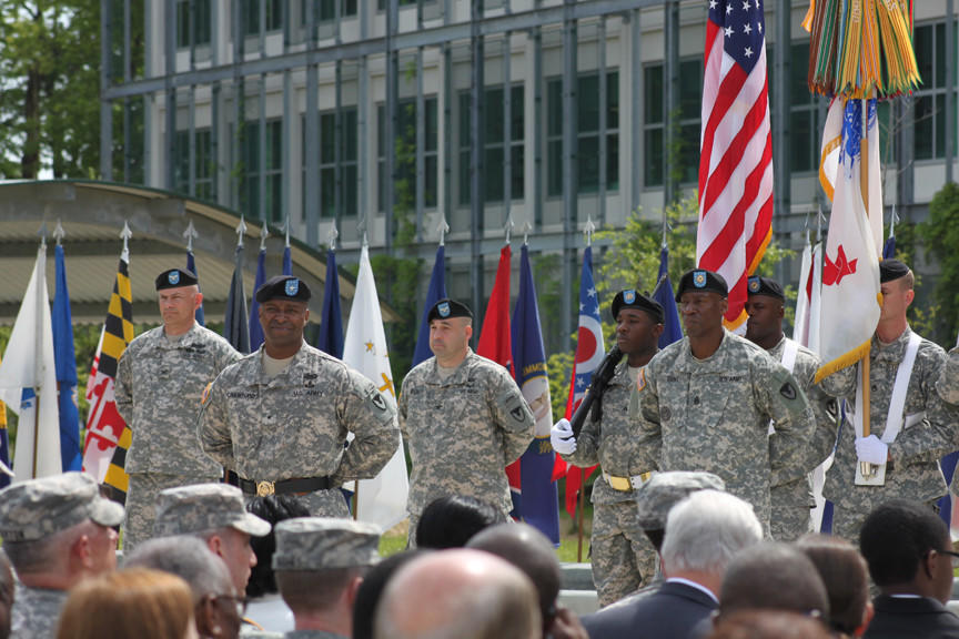 Brig. Gen. Bruce T. Crawford, front left, commanding general, U.S. Army Communications-Electronics Command (CECOM), stands along side CECOM Command Sgt. Major Kennis Dent at parade rest, during Crawford's assumption of command ceremony held Tuesday morning at the C4ISR Center of Excellence Campus on Aberdeen Proving Ground.