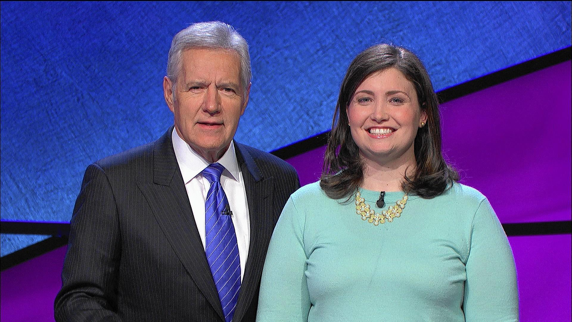 "Wilmette resident and Kenilworth native Julia Collins, 31, right, pictured with ""Jeopardy!"" host Alex Trebek, won her 12th victory on Monday, and now holds the distinction of what game show officials are calling ""the third-winningest"" contestant of all time."