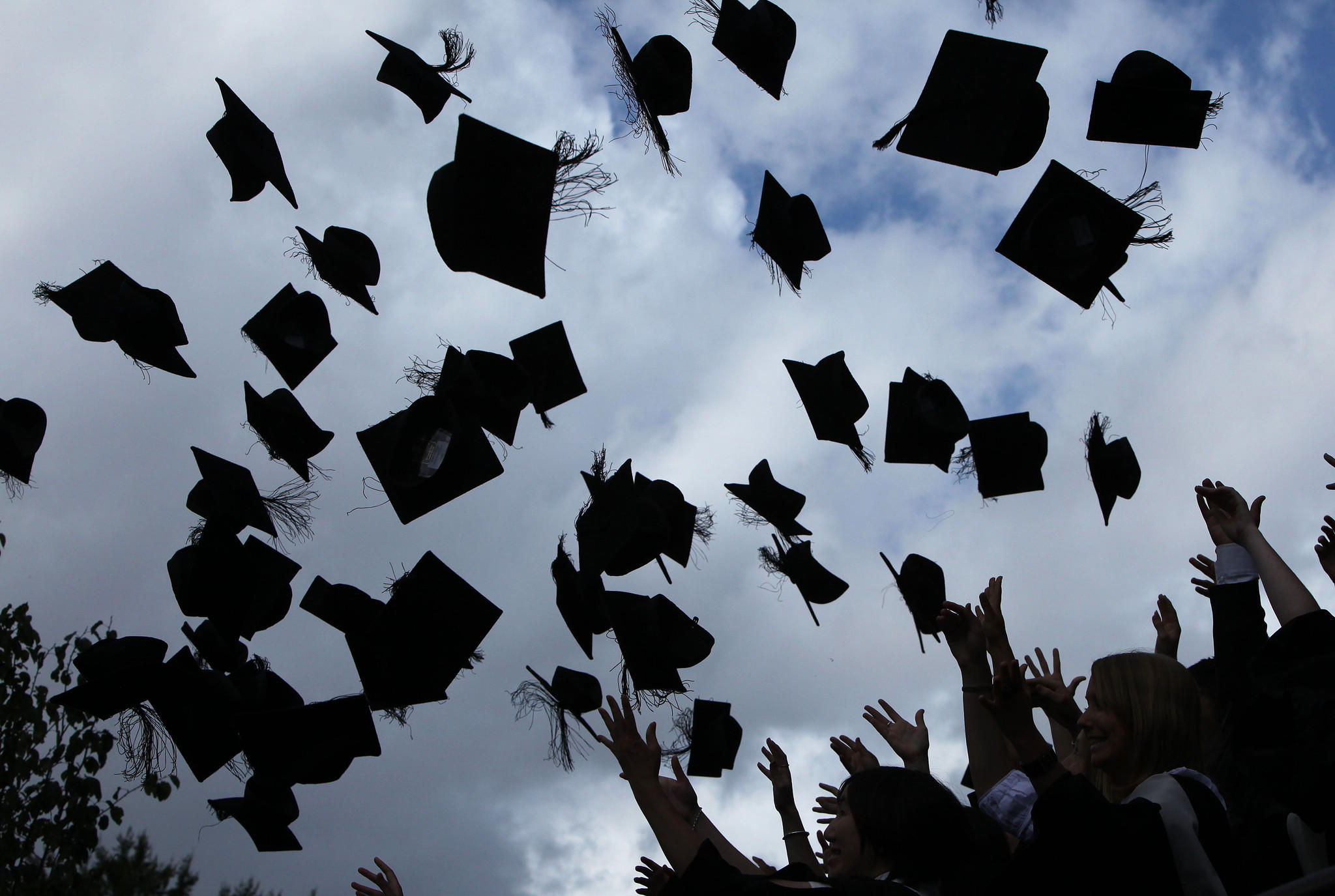 File photo shows students throwing their mortarboards in the air during their graduation.