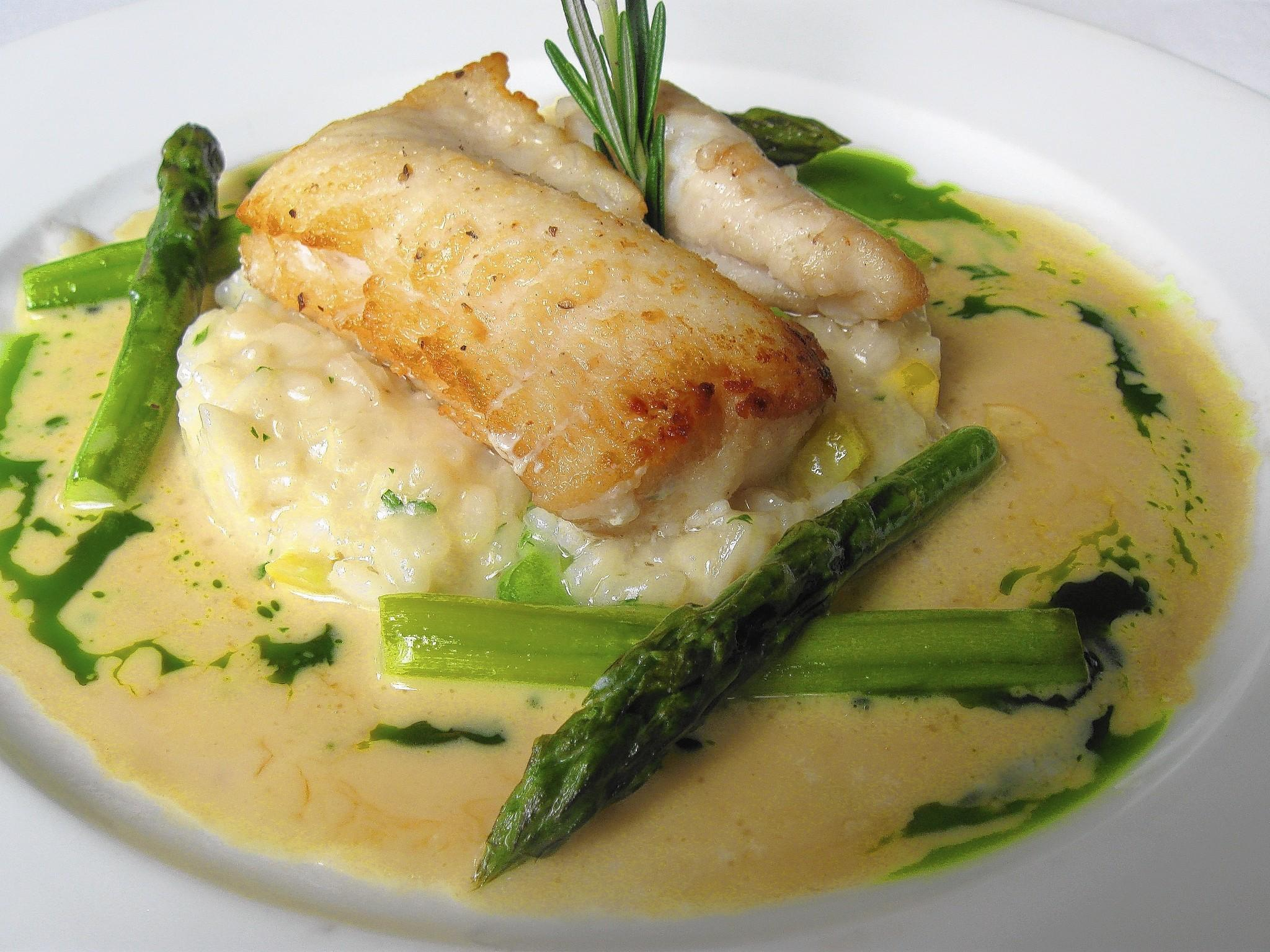 Wolfish was sautéed in butter and served on risotto, flecked with yellow zucchini and peas.