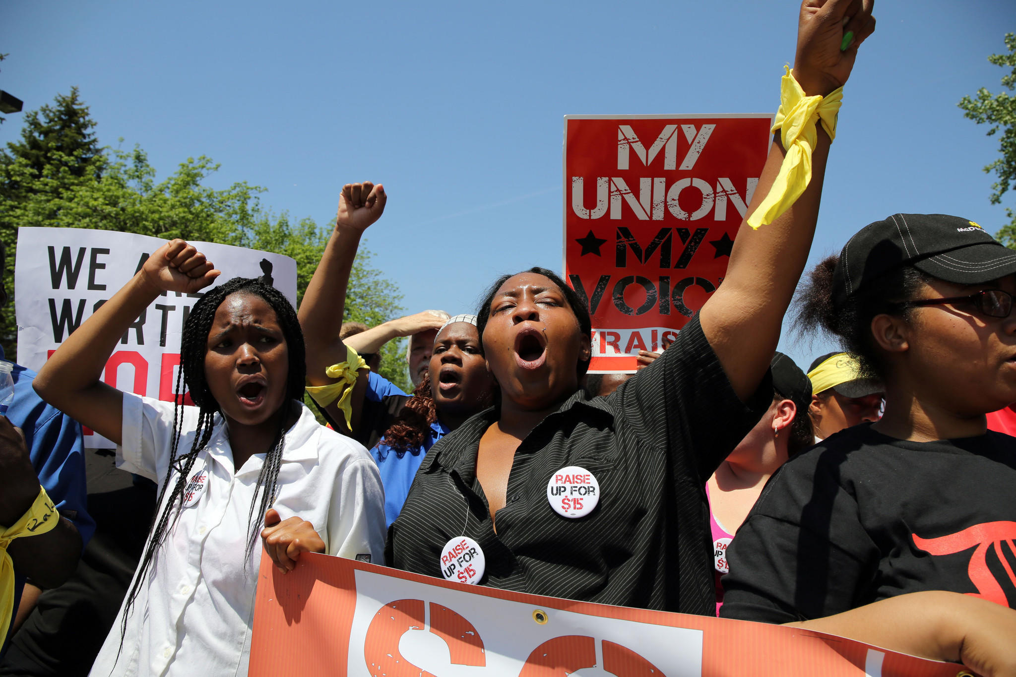 Protesters demonstrate outside of McDonald's headquarters in Oak Brook Wednesday afternoon.