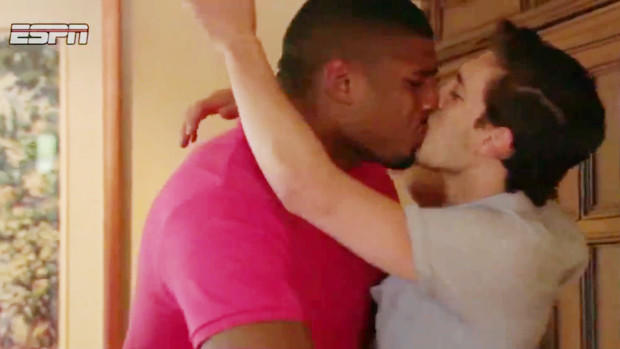 Michael Sam and boyfriend Vito Cammisano kiss in an ESPN TV image after Sam was selected in the NFL draft on May 10.