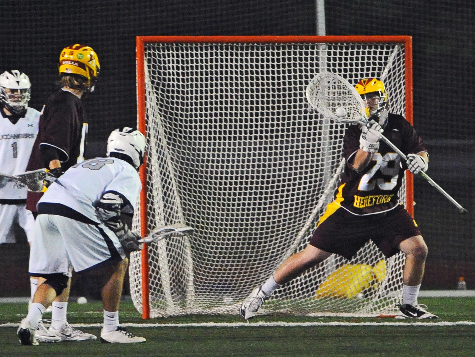 Hereford goalie Brock Turnbaugh, right, makes a save on a shot by Kent Island's Patrick Garvey, third to the left, in the third quarter.