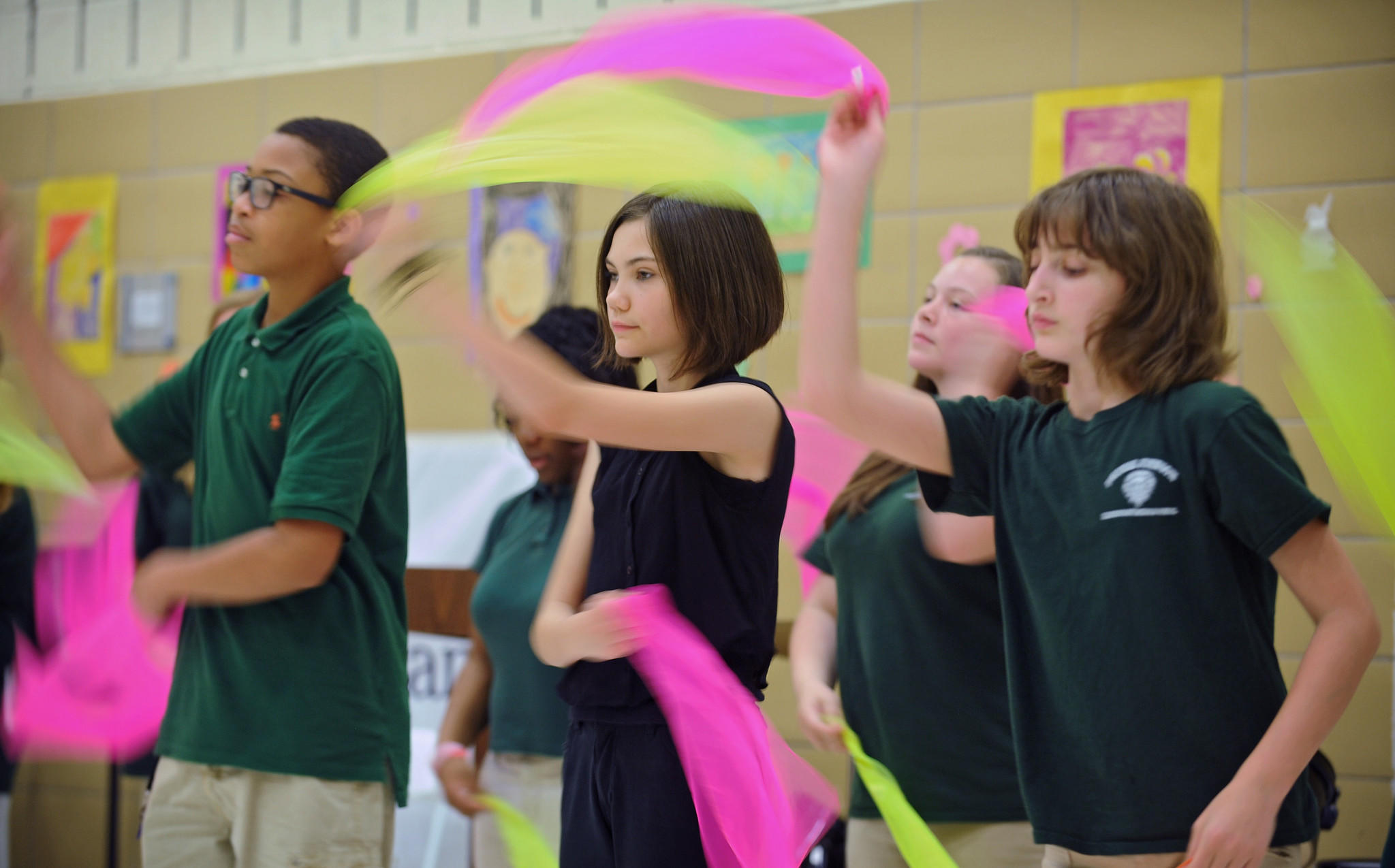 """Thomas Johnson Elementary/Middle School seventh-grader Emily Nolan, center, and others on the school's dance team perform during the school's Spring Arts Festival. Thomas Johnson Middle was named an """"opportunity"""" school in a research report."""