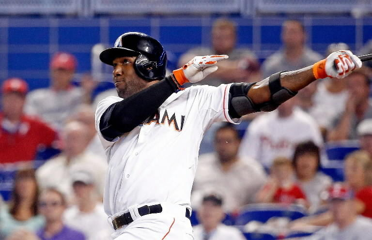 Marcell Ozuna #13 of the Miami Marlins hits a two-run home run during the seventh inning of the game against the Philadelphia Phillies at Marlins Park on May 22, 2014 in Miami, Florida