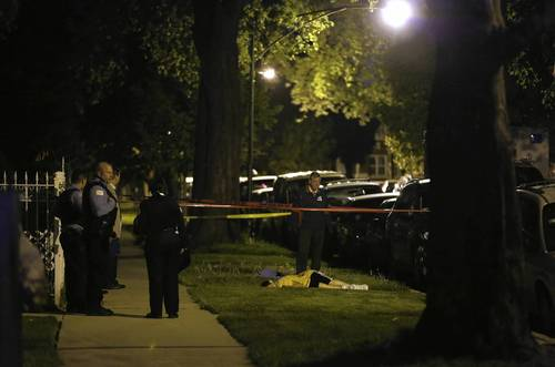 Chicago Police stand near the body of 14-year-old Kevin Diaz.