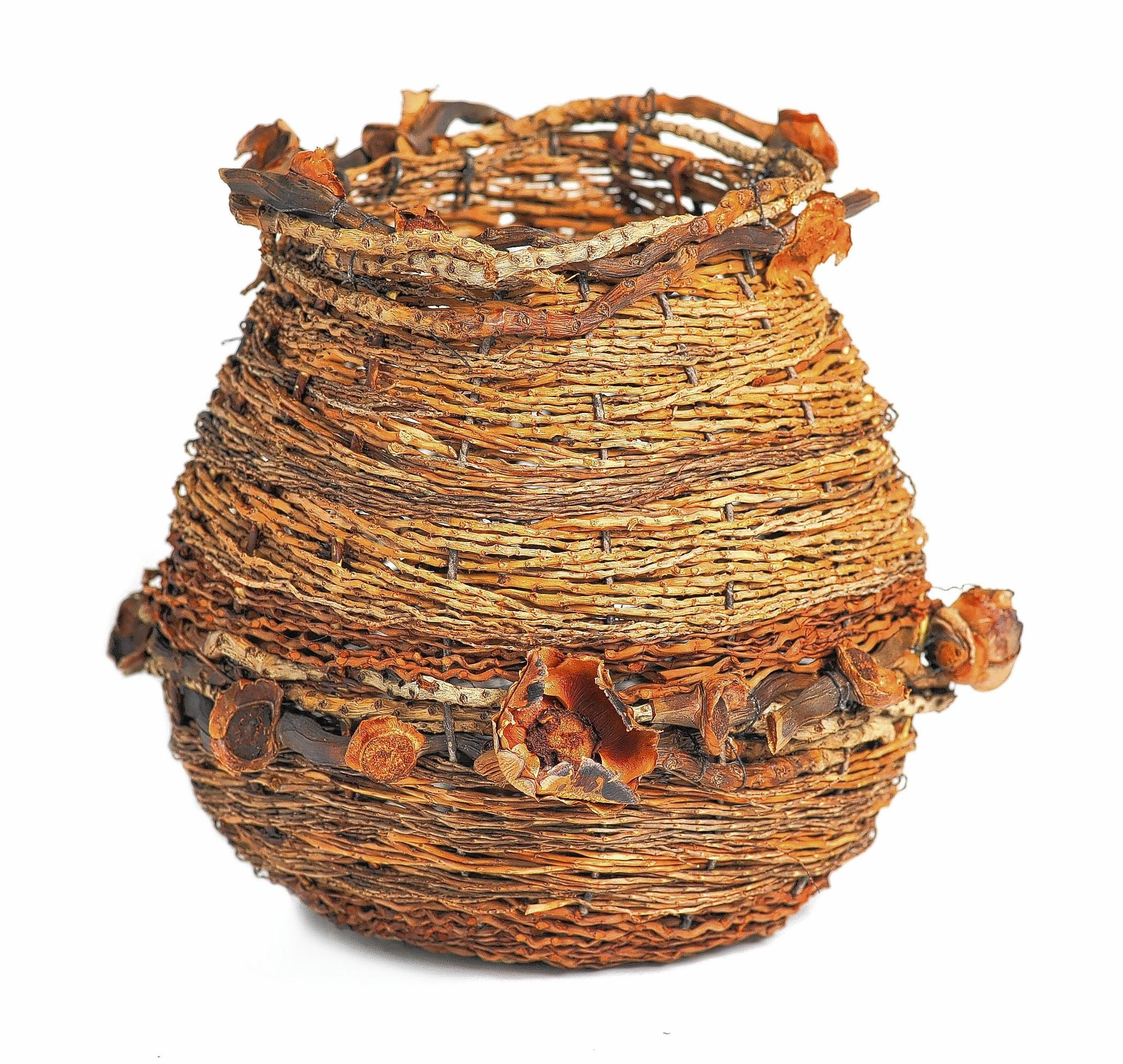 A decorative basket from EarthArt by Mary and Teri, using all-natural material plucked from South Florida's backyard.