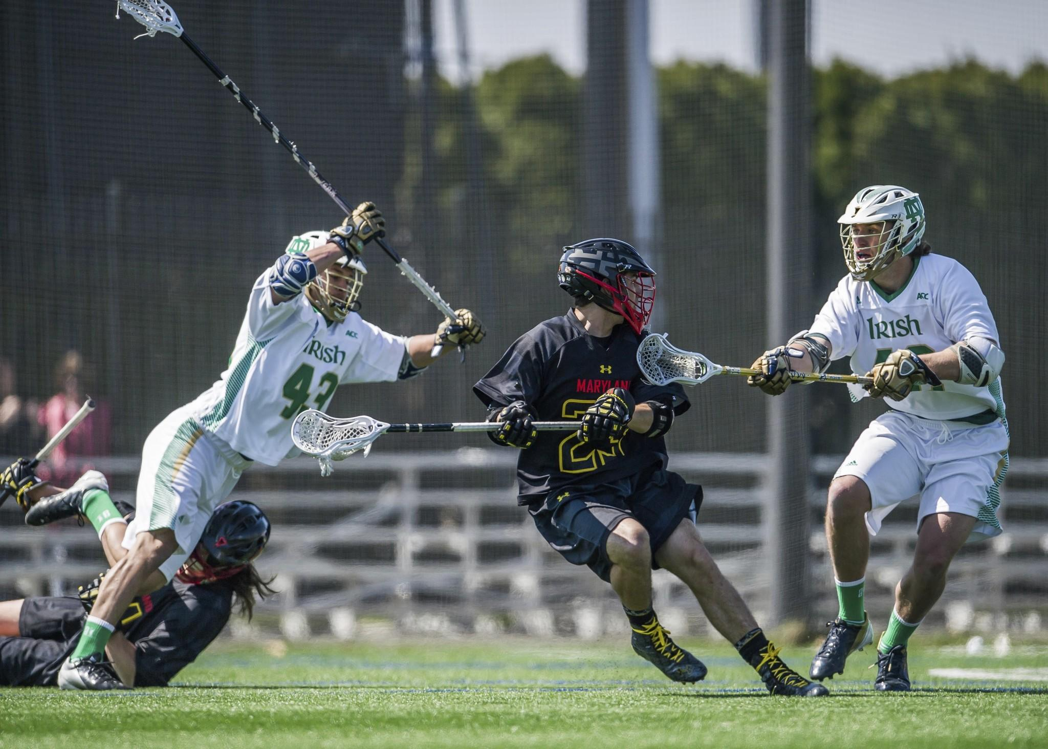 Maryland midfielder Connor Cannizzaro (middle) moves the ball as Notre Dame defensemen Matt Landis (43) and Matthew Collins (42) defend in the first quarter at Arlotta Stadium.