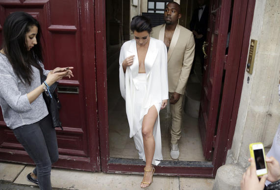 Kim Kardashian and Kanye West leave their residence in Paris on May 23, on the afternoon of the day before their wedding.