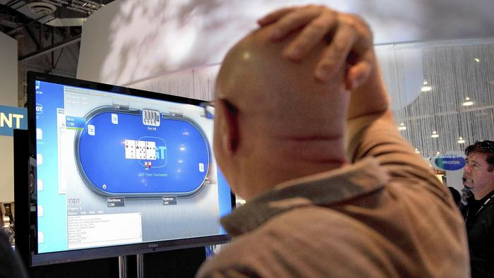 Will PokerStars be dealt out of legalized online poker in California? - Los Angeles Times (05/24/2014)