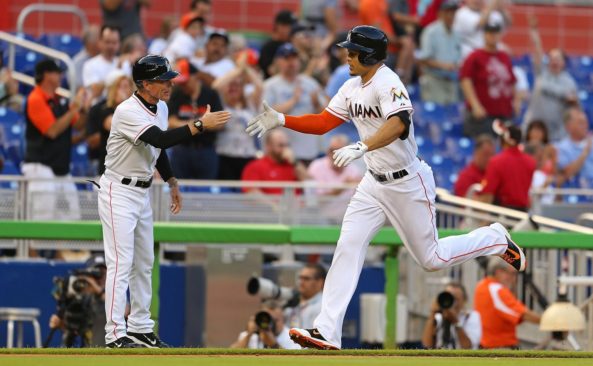 MIAMI, FL - MAY 23: Giancarlo Stanton #27 of the Miami Marlins hits a solo home run during a game against the Milwaukee Brewers at Marlins Park on May 23, 2014 in Miami, Florida.