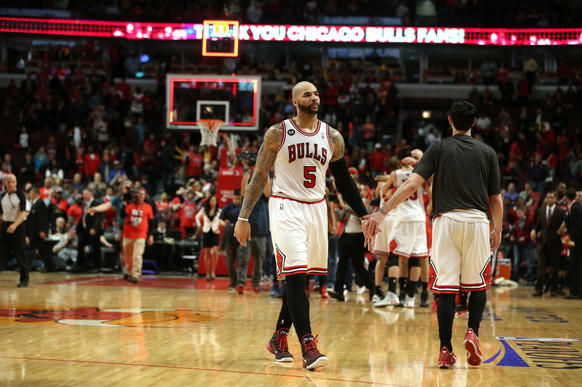 Carlos Boozer walks off the floor after losing Game 5 to the Wizards in the playoffs.