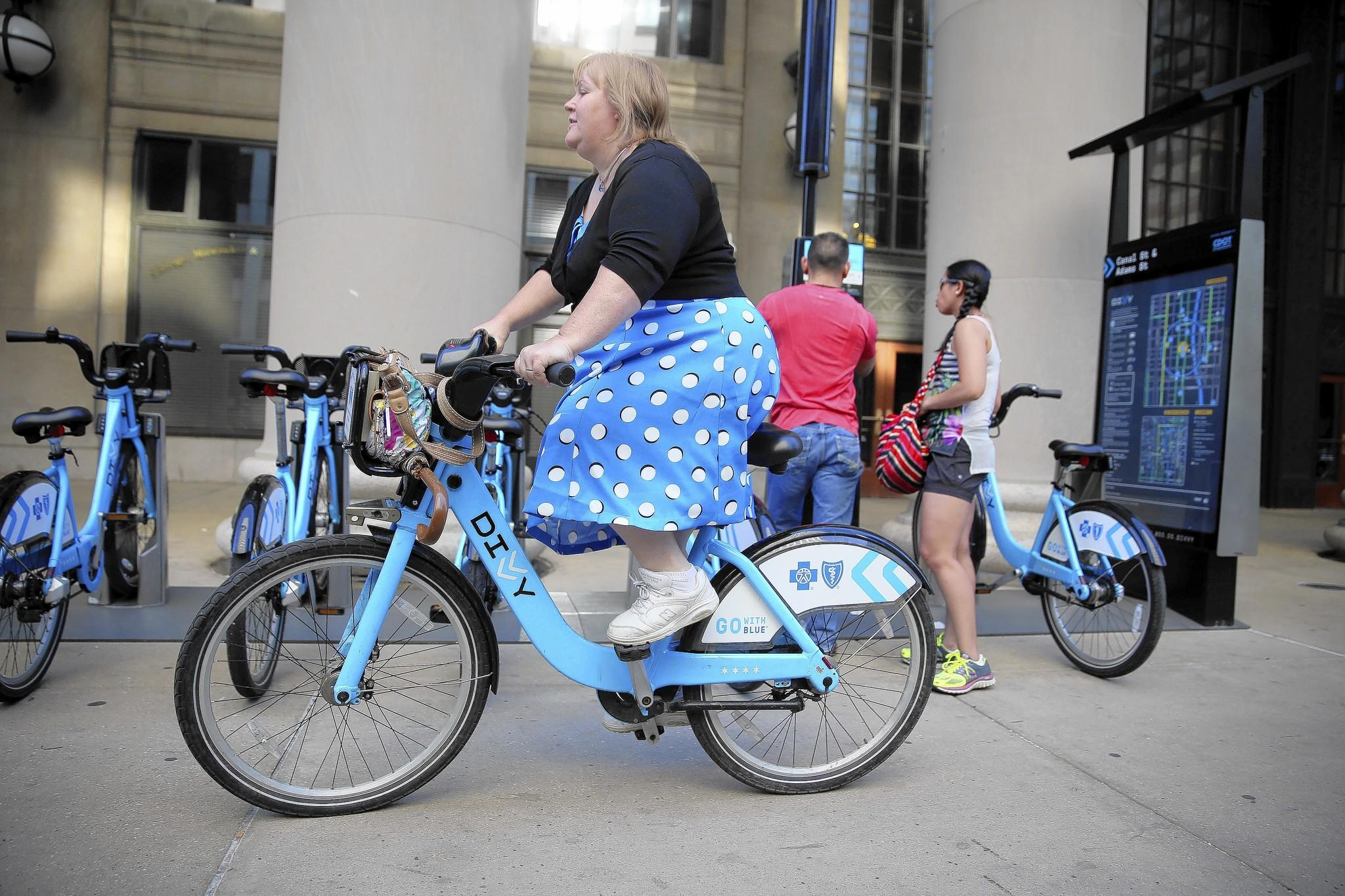 Sherri Frickel, of Hammond, rides a Divvy bike last week from a station at 225 S. Canal St., near her workplace in Chicago, to the South Shore Line that will take her home after work.