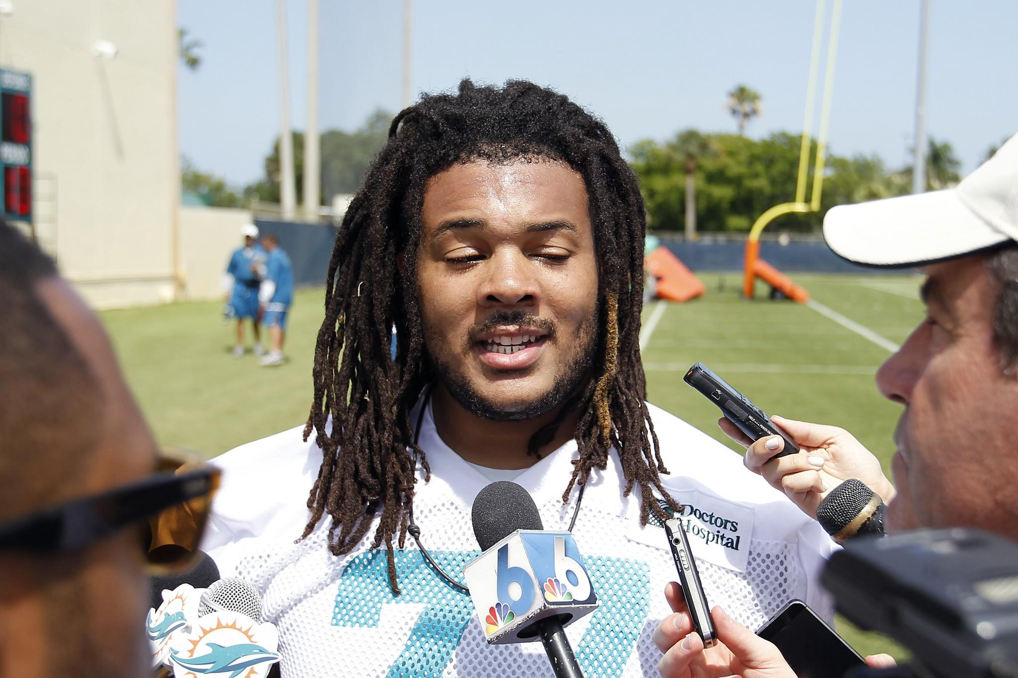 Billy Turner #77 of the Miami Dolphins talks to the media after the rookie minicamp on May 23, 2014 at the Miami Dolphins training facility in Davie, Florida.