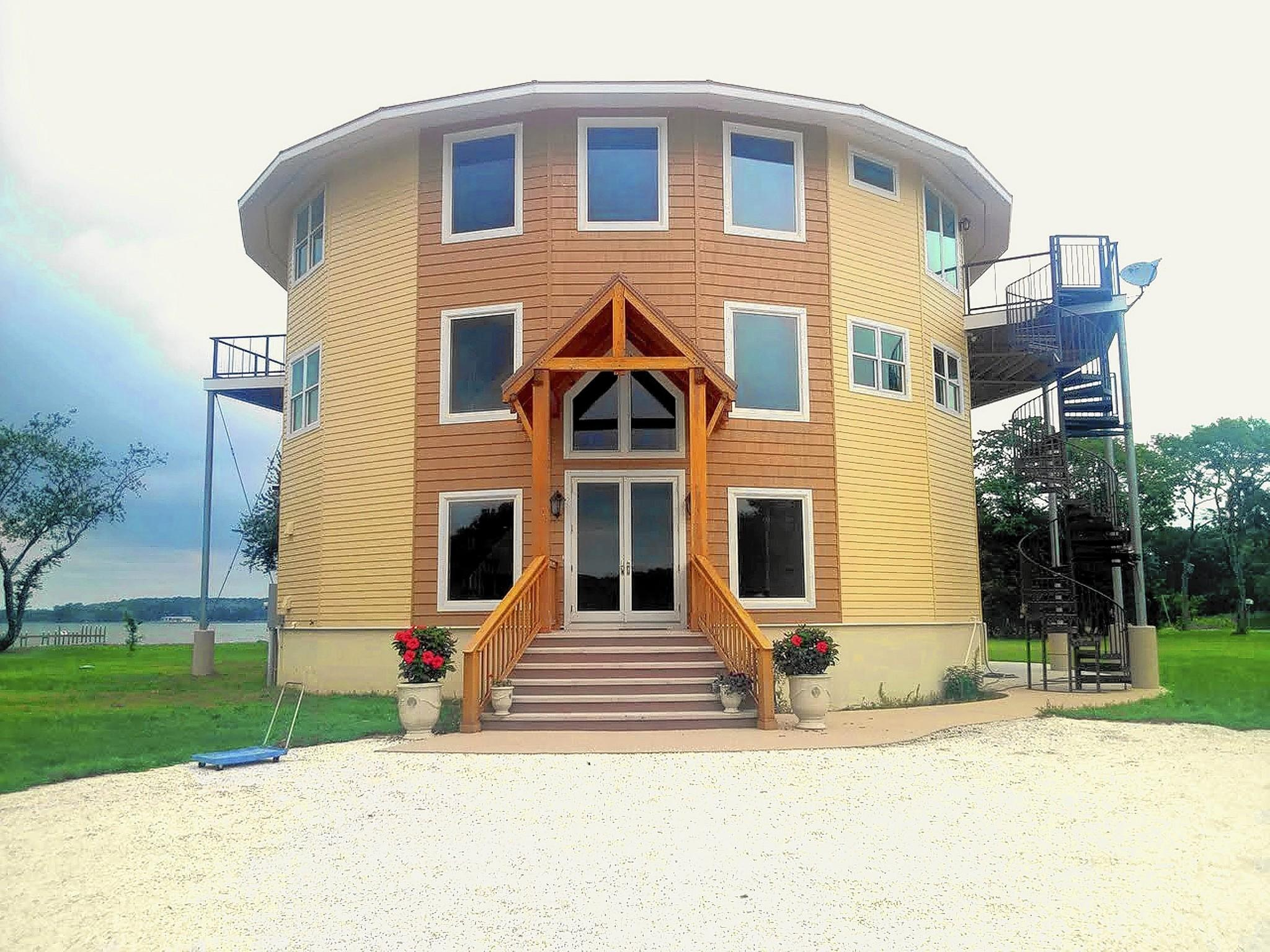 Hurricane resistant living life in a round house can for Hurricane resistant house plans