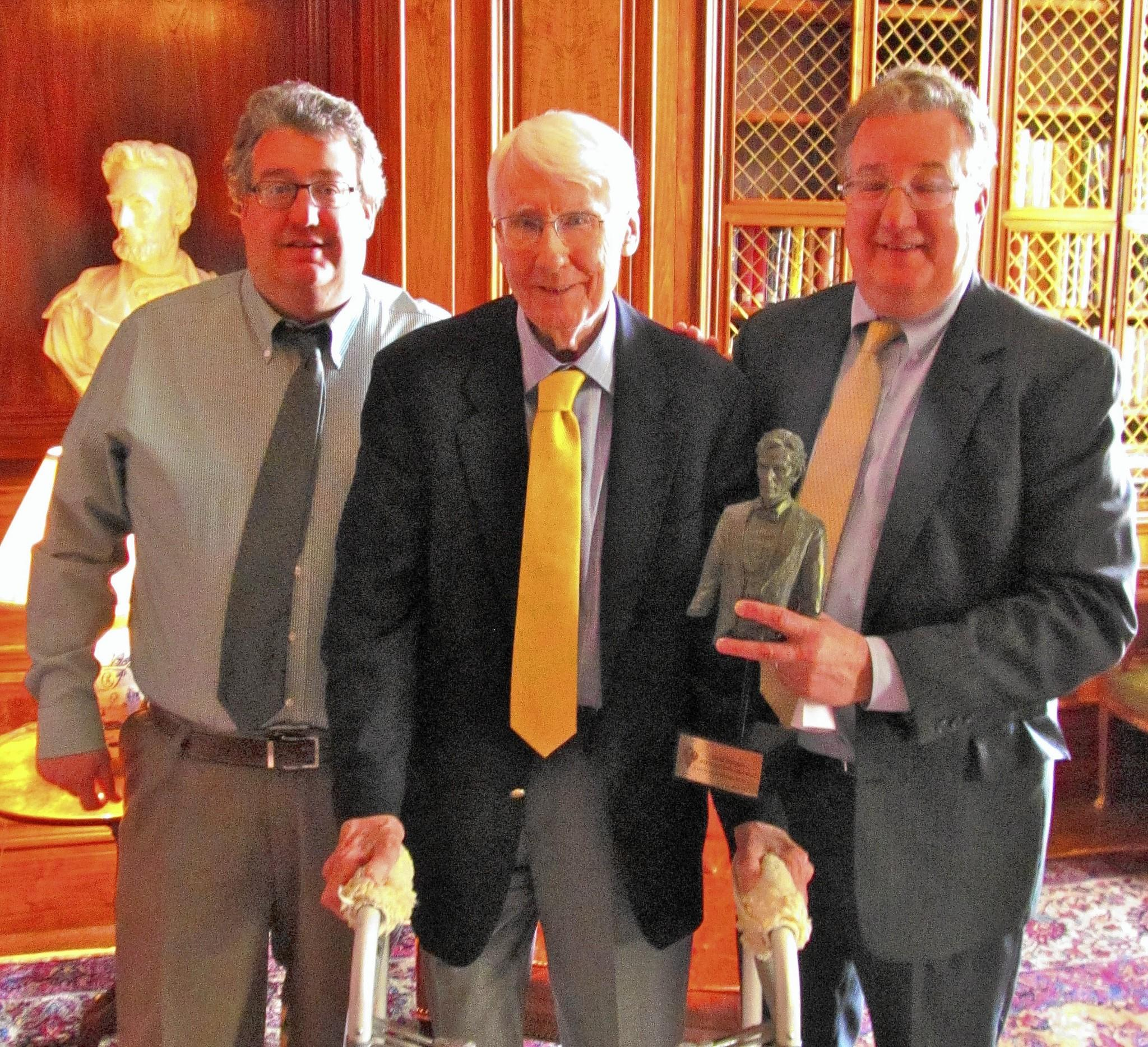 Retired New Trier High School teacher, David Dickman, 84, of Wilmette, was recently given a lifetime achievement award by The Illinois State Historical Society. Dickman (center) is flanked by his sons, Steve Dickman (left) and Larry Dickman (right) who were in Springfield for the April 26 award ceremony.