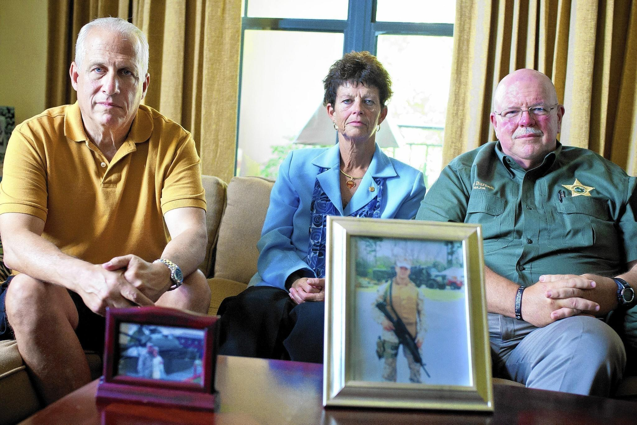 Greg LiCalzi, left, father of Lt. Mike LiCalzi, pictured below him, and Shelley and Ron Burnett, parents of Marine Lance Cpl. Jason Burnett, pictured below them. Marines Jason Burnett and Mike LiCalzi both died serving their country in Iraq in 2006.