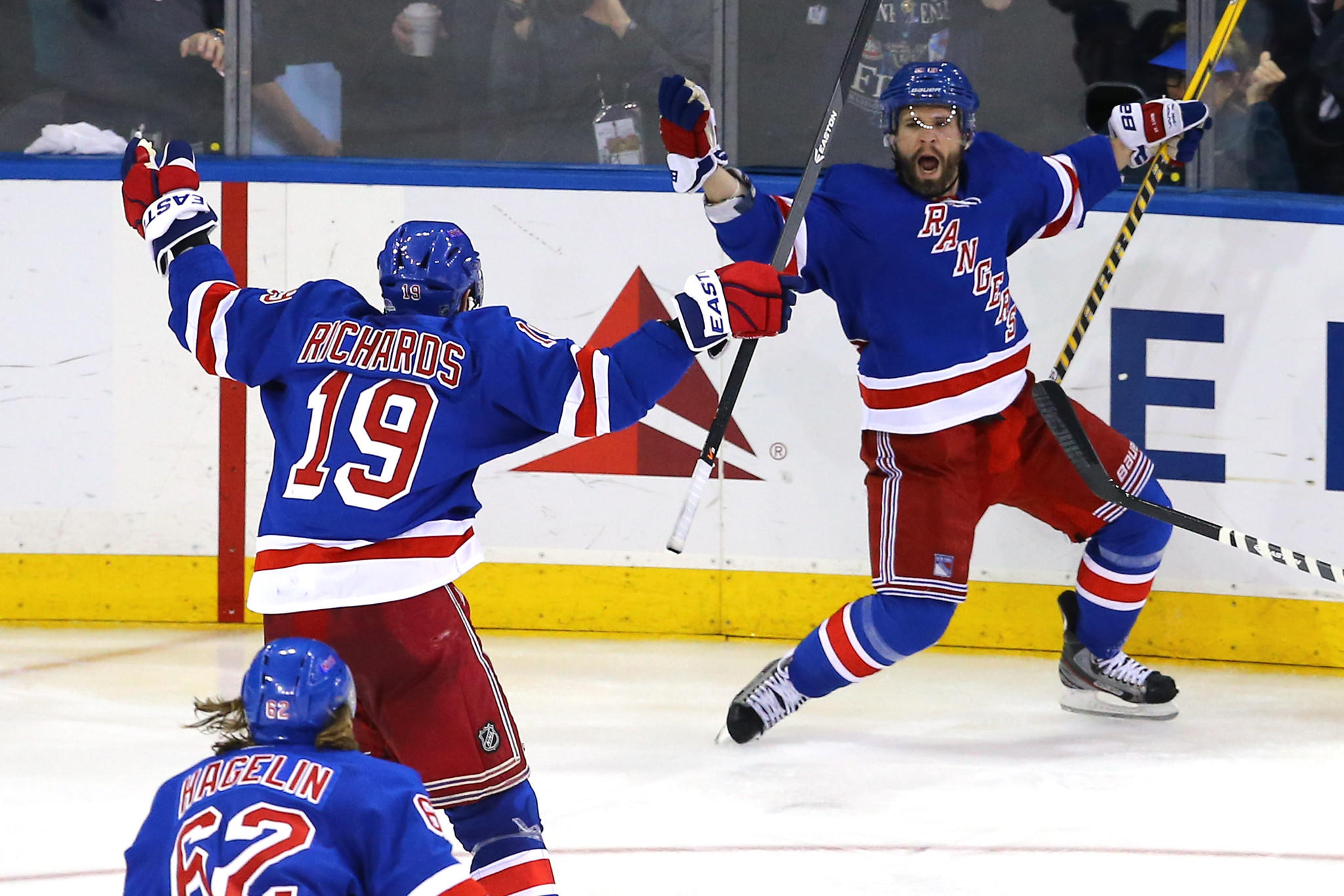 Martin St. Louis, right, celebrates his overtime goal with teammate Brad Richards as the Rangers beat the Canadiens 3-2 to take a 3-1 series lead.