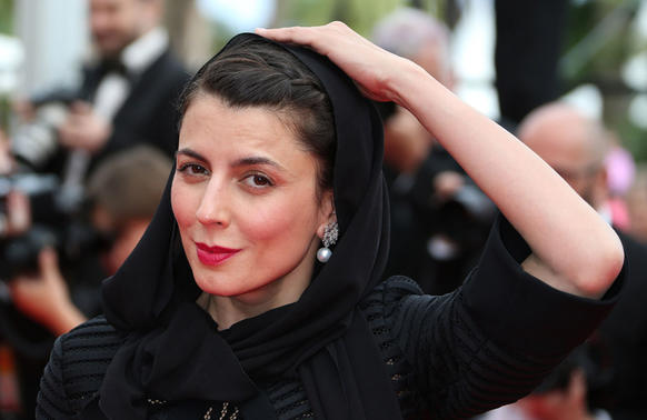 Iranian actress and member of the feature films Jury Leila Hatami smiles as she arrives for the screening of the Palme d'Or winner at the Cannes Film Festival.