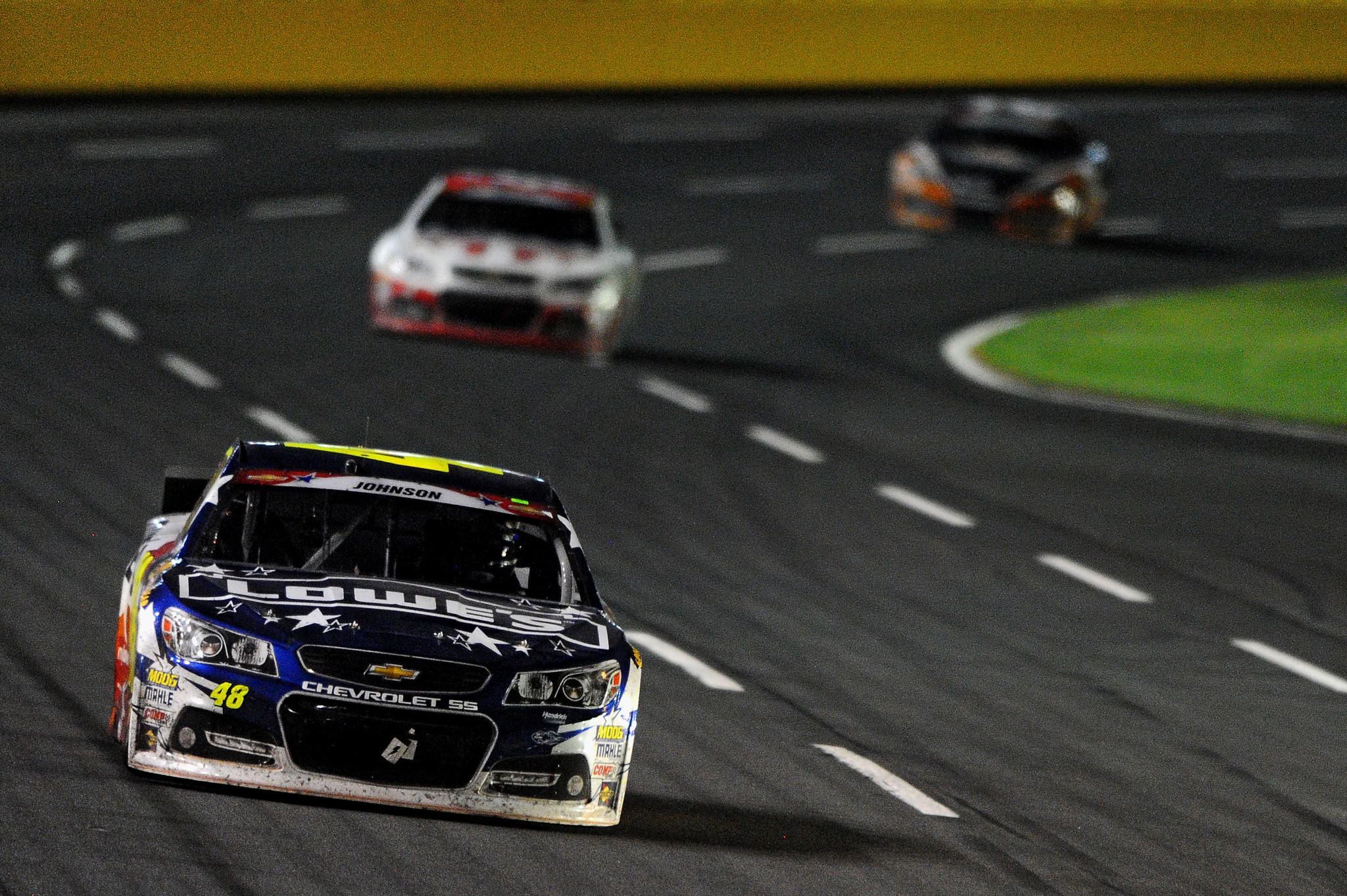 Jimmie Johnson, driver of the #48 Lowe's Patriotic Chevrolet, leads the field during the NASCAR Sprint Cup Series Coca-Cola 600 at Charlotte Motor Speedway on May 25, 2014 in Charlotte, North Carolina.