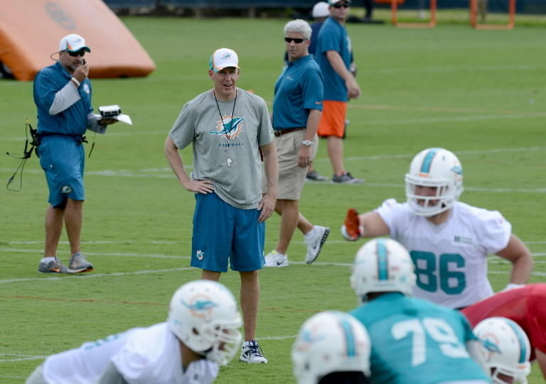 Miami Dolphins head coach (middle) Joe Philbin watches players run threw drills during the beginning of phase three of OTA practice session Tuesday morning in Davie.