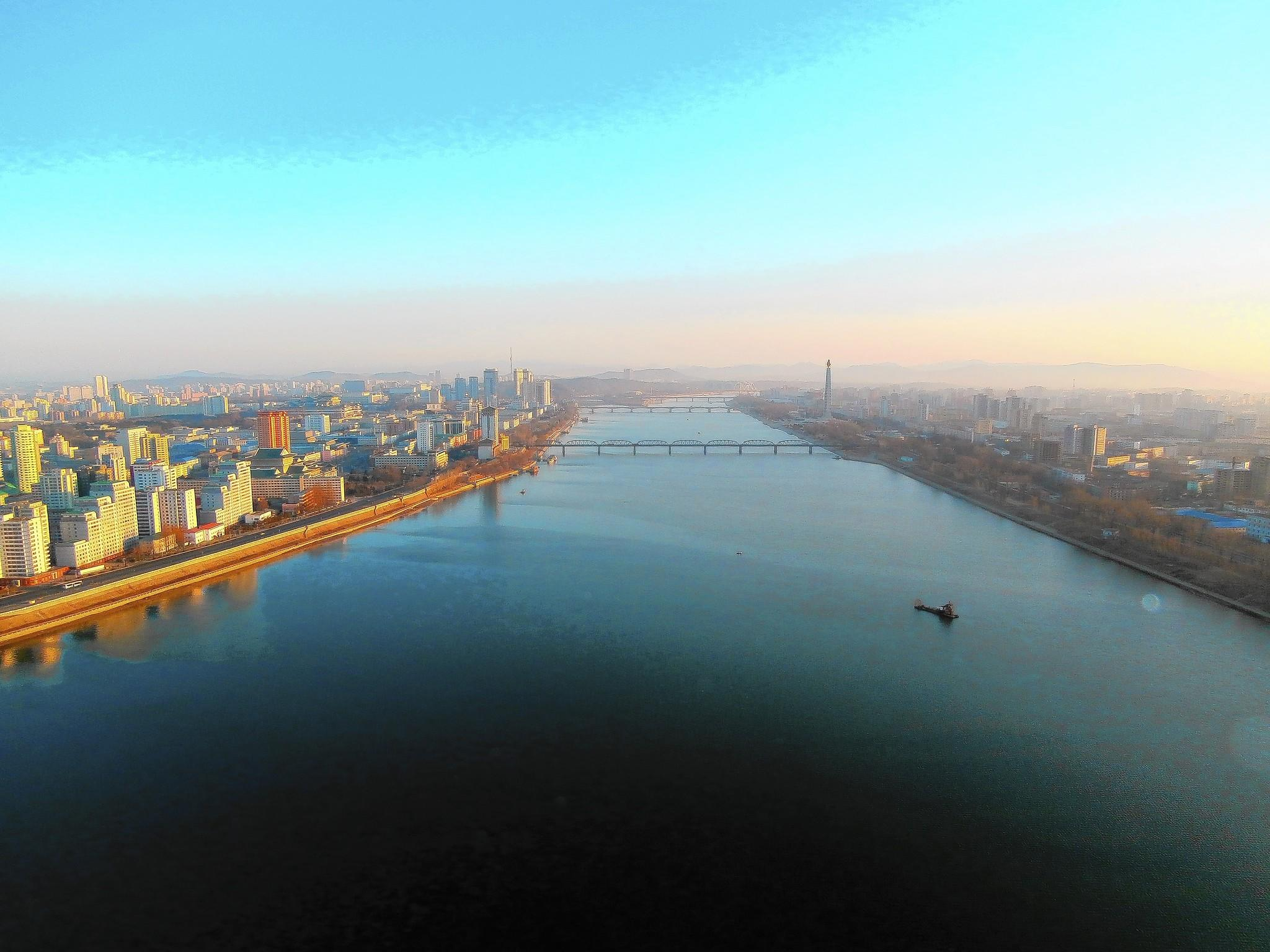 Pyongyang in the morning, on the Taedong River.