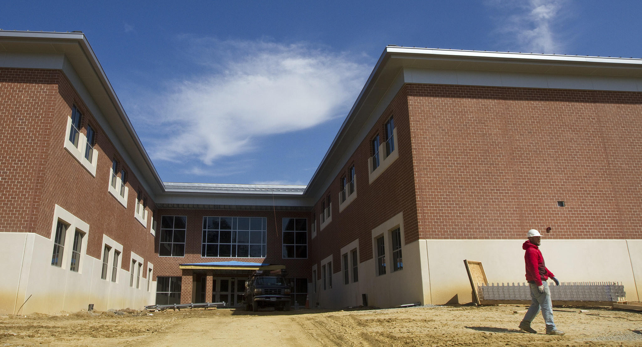 An employee walks by the side entrance of the Georgie D. Tyler Middle School construction site on Thursday in Windsor.