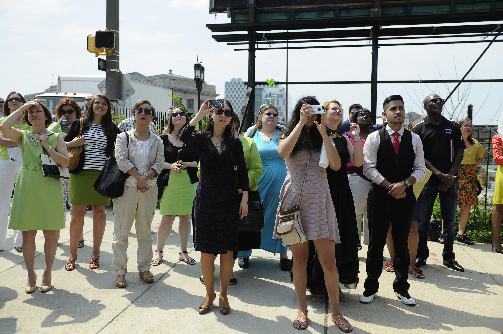 People watch aerial artists from DNA Theater perform at a press conference announcing events for the upcoming Artscape 2014 event which will take place in July.