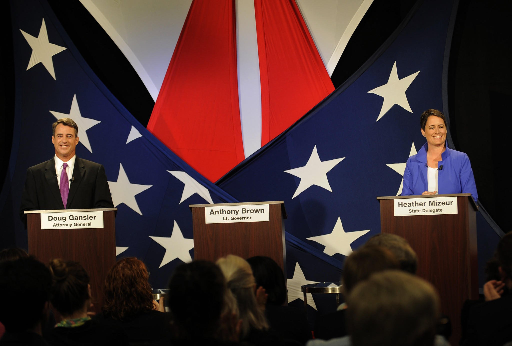 Gubernatorial candidates Attorney General Doug Gansler and state Del. Heather Mizeur debate each other across an empty podium for Lt. Gov. Anthony Brown at WBFF Fox 45 on May 27.