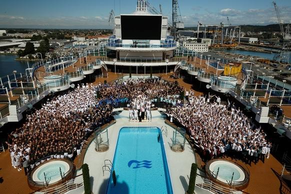 The entire ship's company of the new Regal Princess, along with Princess President Jan Swartz (center), gather to celebrate the ship's debut in Venice, Italy on May 20, 2014.