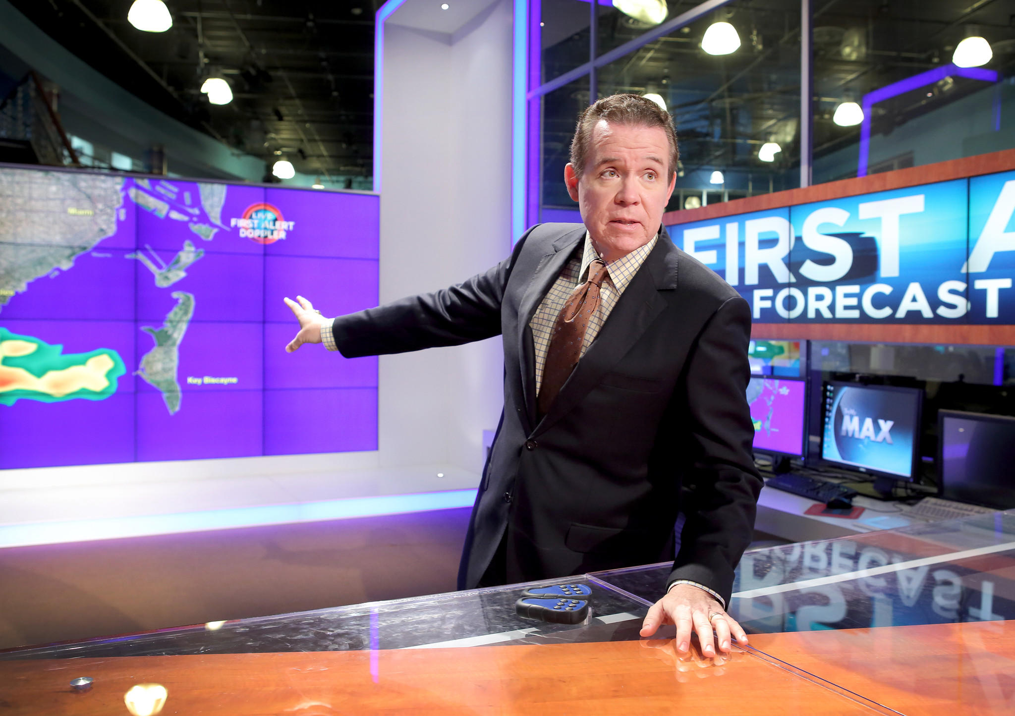 John Morales, NBC 6 channel's meteorologist, works at the Studio on May 26, 2014.