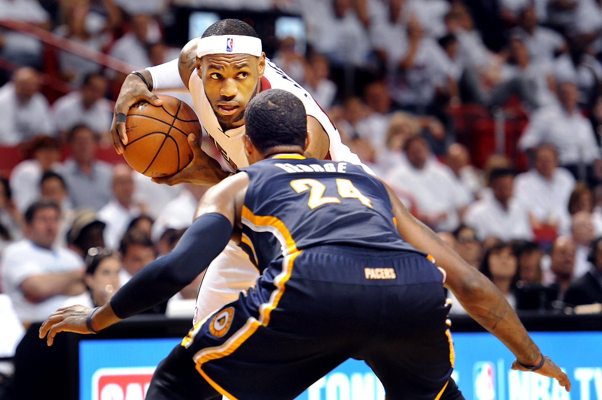 -The Miami Heat host the Indiana Pacers at American Airlines Arena for Game 4 of the Eastern Conference Finals. LeBron James prepares to take on Indiana's Paul George in a one on one.