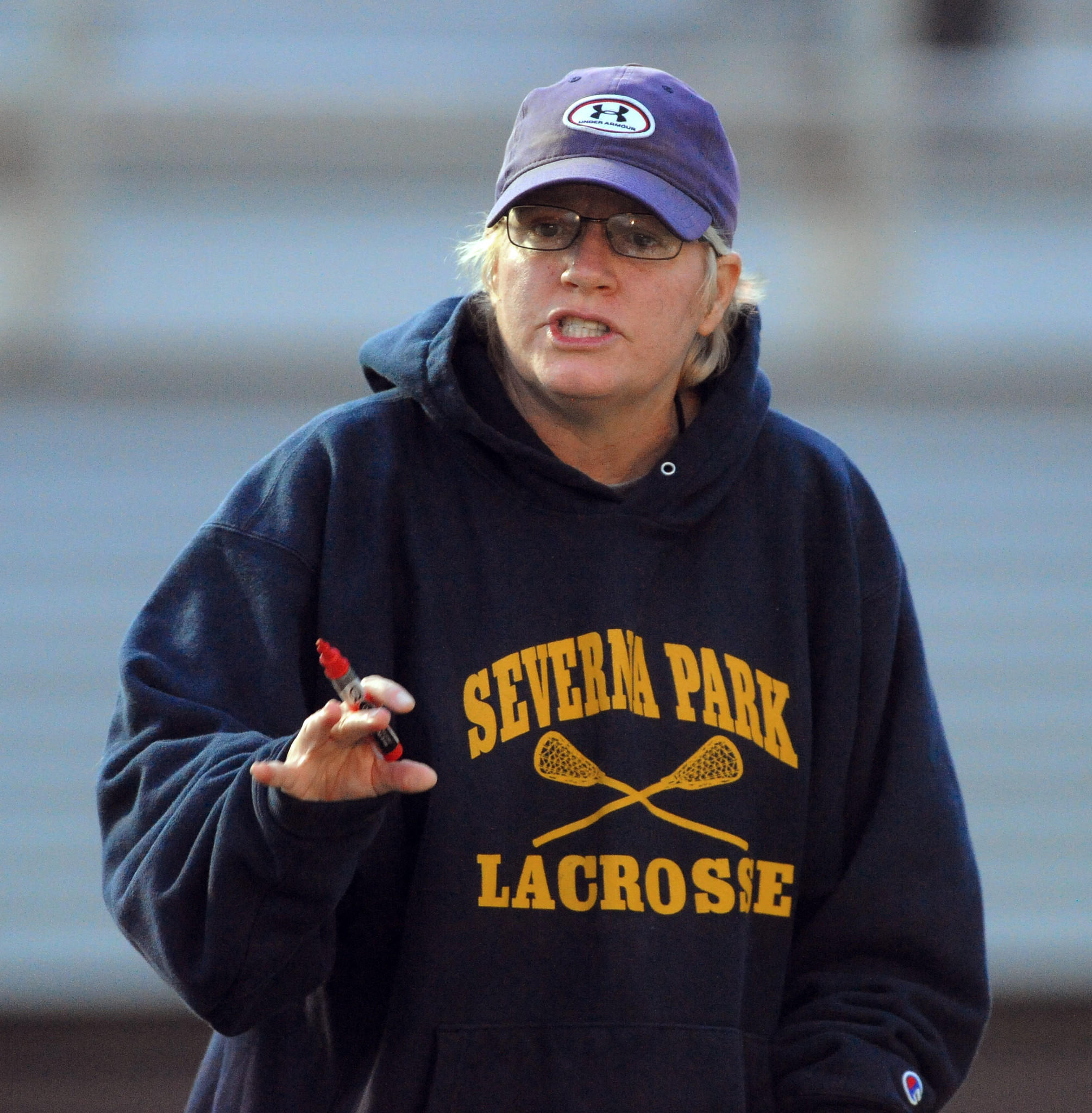 Girls lacrosse coach Carin Peterson coaches Severna Park in April.