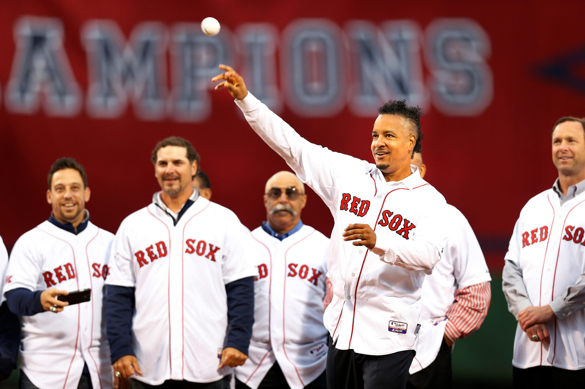 Boston Red Sox former player Manny Ramirez throws out the first pitch before the game against the Atlanta Braves at Fenway Park.