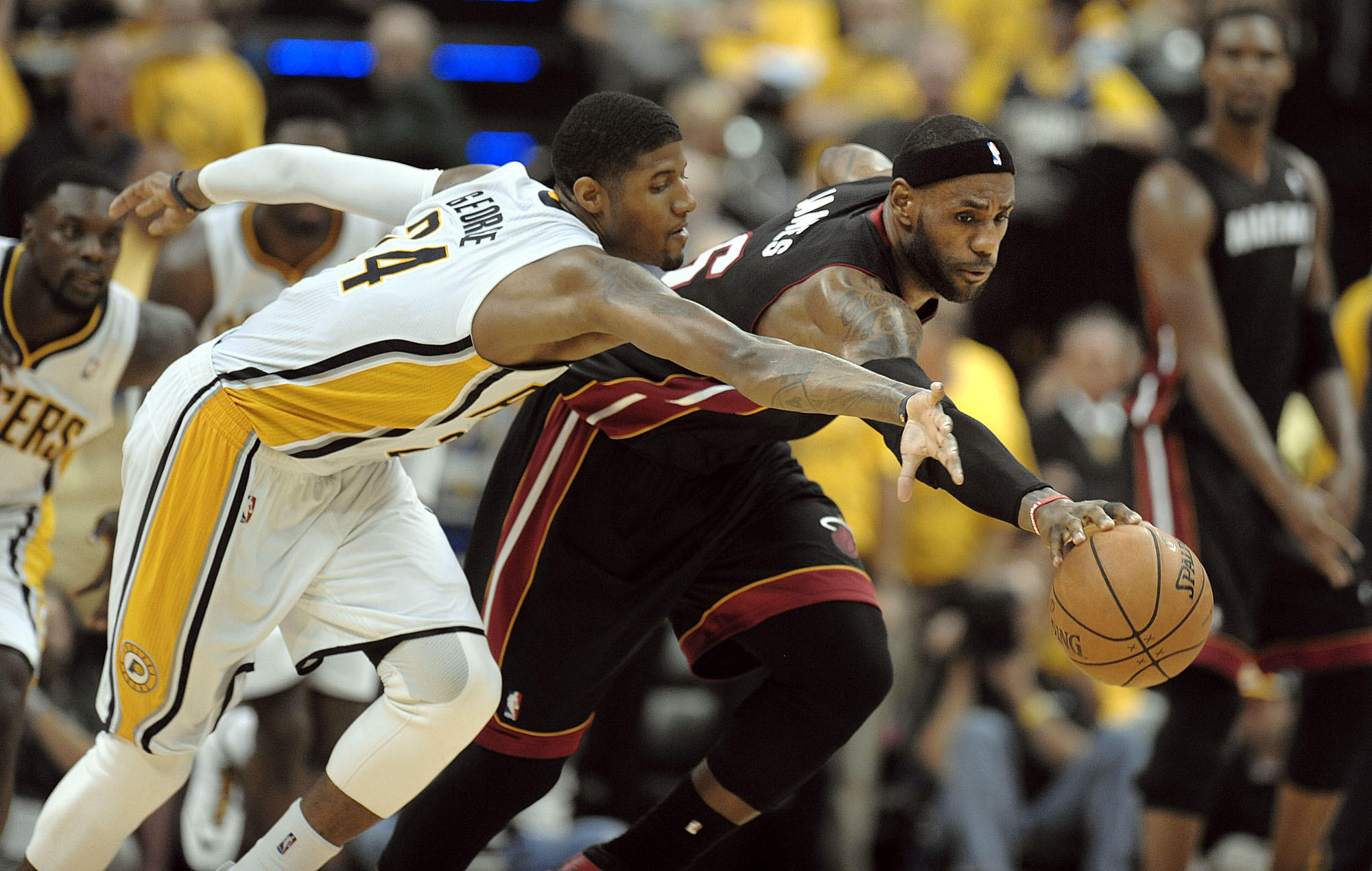 Miami Heat forward LeBron James chases down the ball in front of Indiana Pacers forward Paul George during the second half of Game 5 of the Eastern Conference Finals, Wednesday, May 28, 2014, at Bankers Life Fieldhouse. Michael Laughlin, South Florida Sun Sentinel