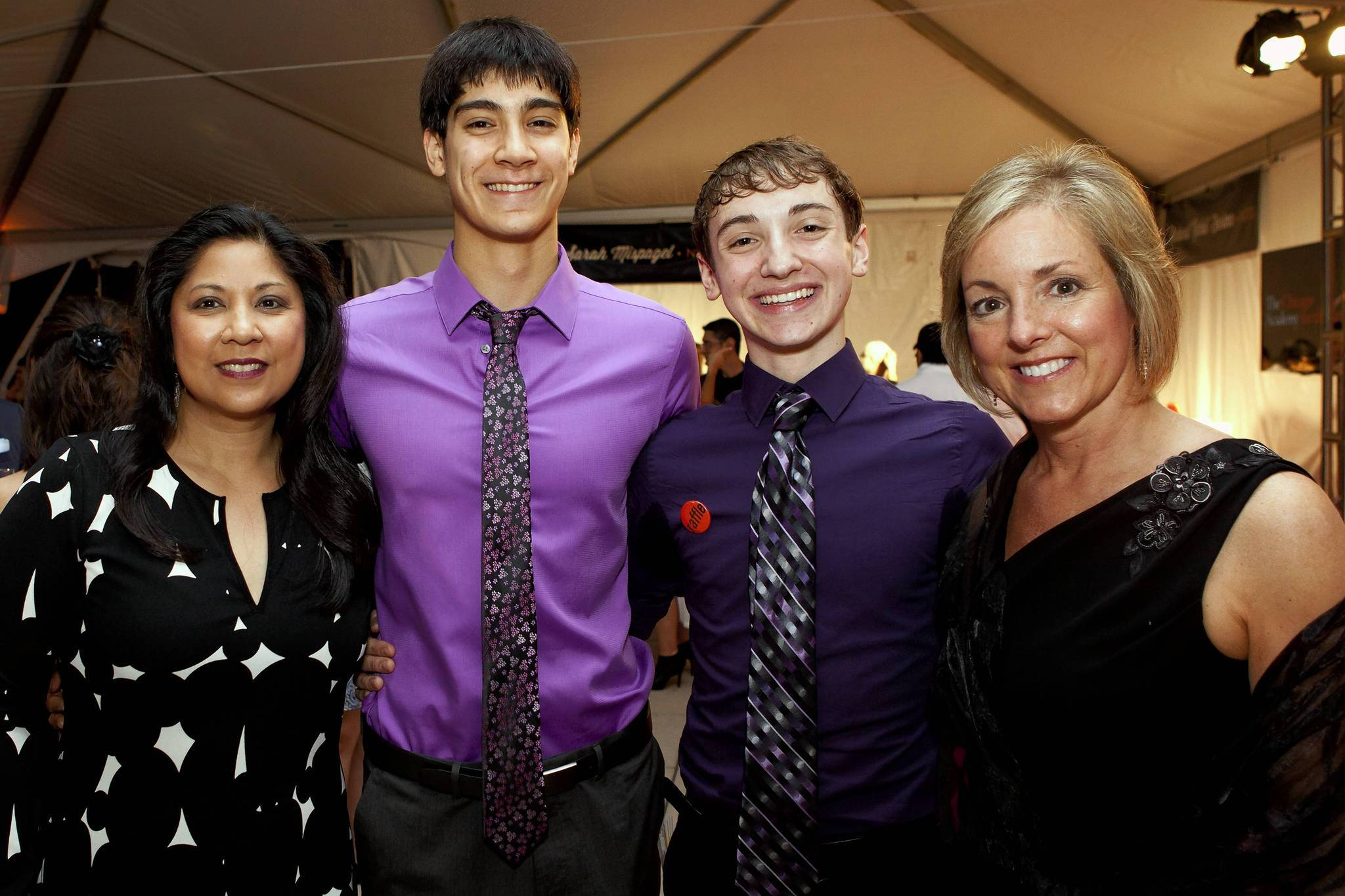 Teresa Aguinaldo; Zachary Gonder, a senior at CAA who will attend Juilliard; Joey Massarelli, a senior at the CAA, who will attend Juilliard; and Catherine Massarelli at the Taste for the Arts Gala at Millennium Park.
