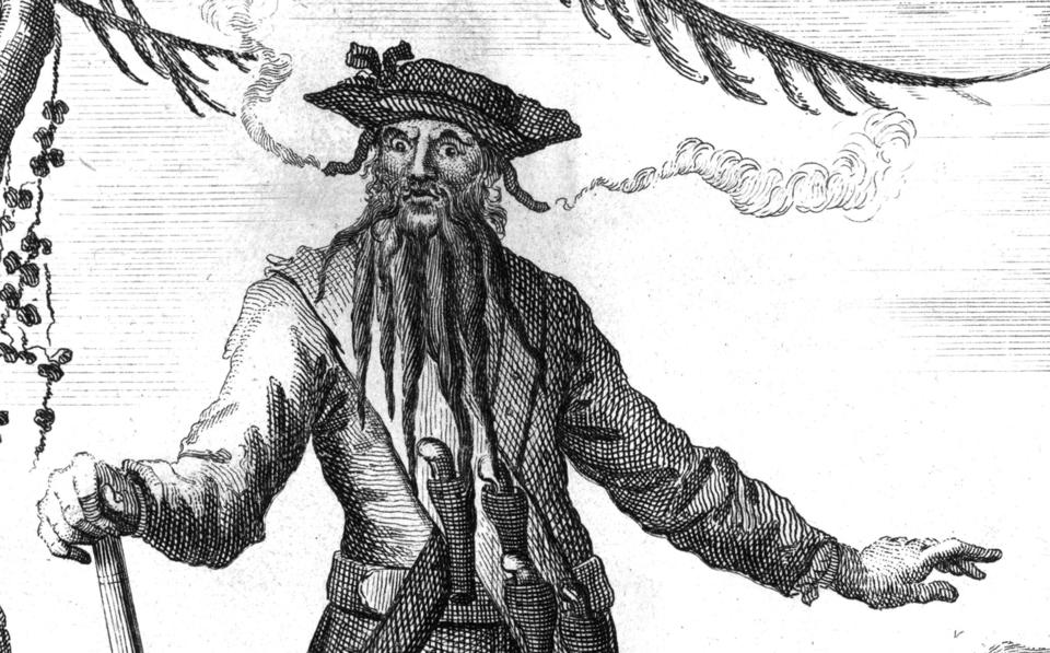 """Festooned with pistols, braids and burning fuses, this fearsome portrait of Blackbeard appeared in the 1736 edition of """"A General History of the Robberies and Murders of the most notorious Pyrates."""""""