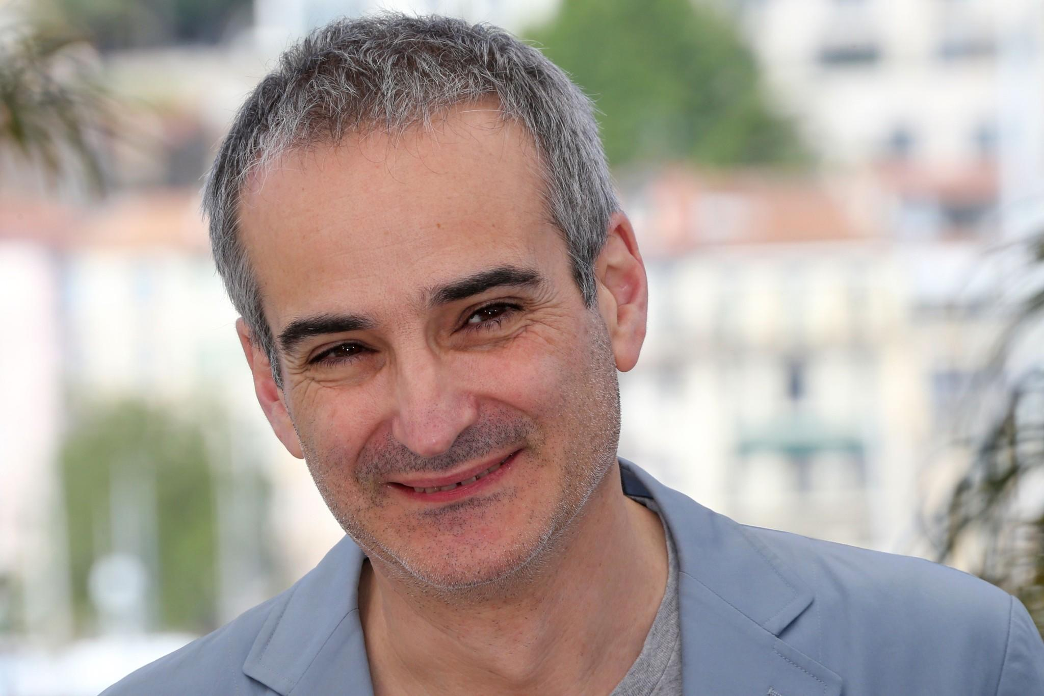 """French director Olivier Assayas poses at the 67th edition of the Cannes Film Festival on May 23. The director will film """"Idol's Eye"""" in Chicago this fall with Robert De Niro and Robert Pattinson."""