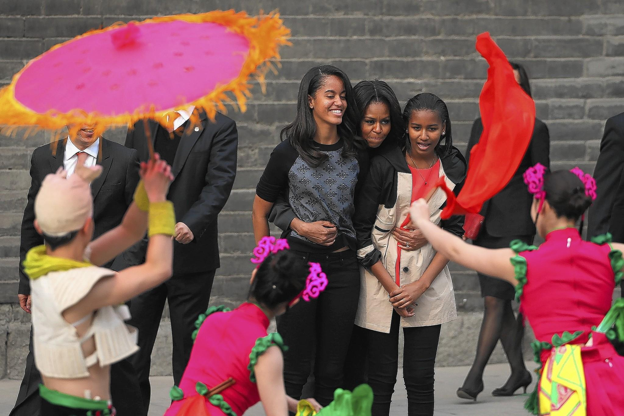 First lady Michelle Obama, center, and her daughters Malia, left, and Sasha visit the Xi'an City Wall on March 24 in Xi'an, China.