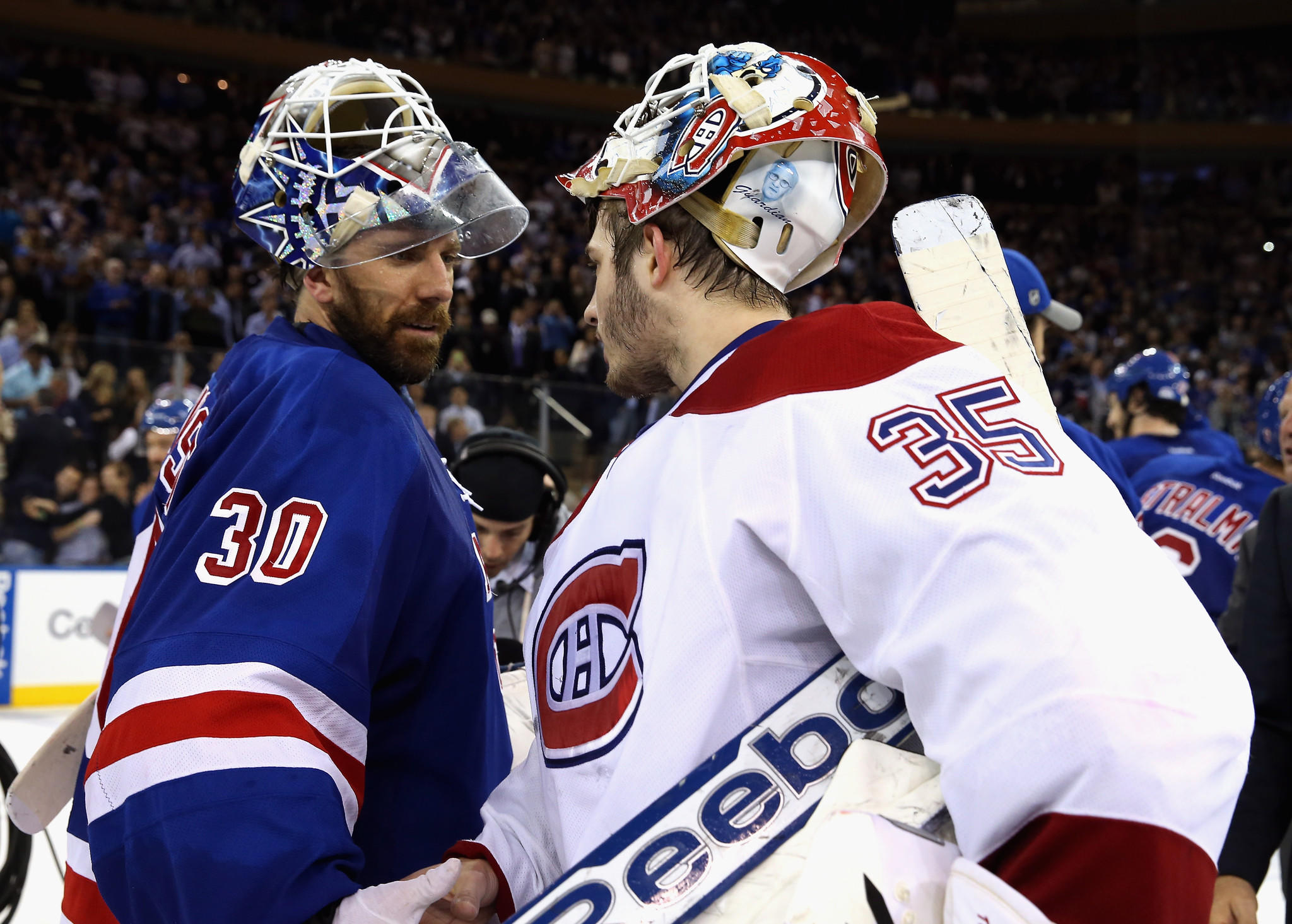 Rangers goalie Henrik Lundqvist, left, shakes hands with Canadiens goalie Dustin Tokarski after shutting out Montreal 1-0 in Game 6 to send New York to the Stanley Cup finals.