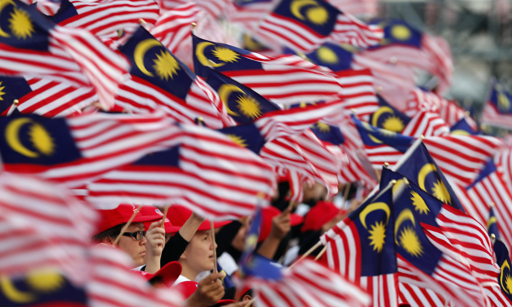 Malaysian flags dwave uring National Day celebrations marking the 56th anniversary of the country's independence.