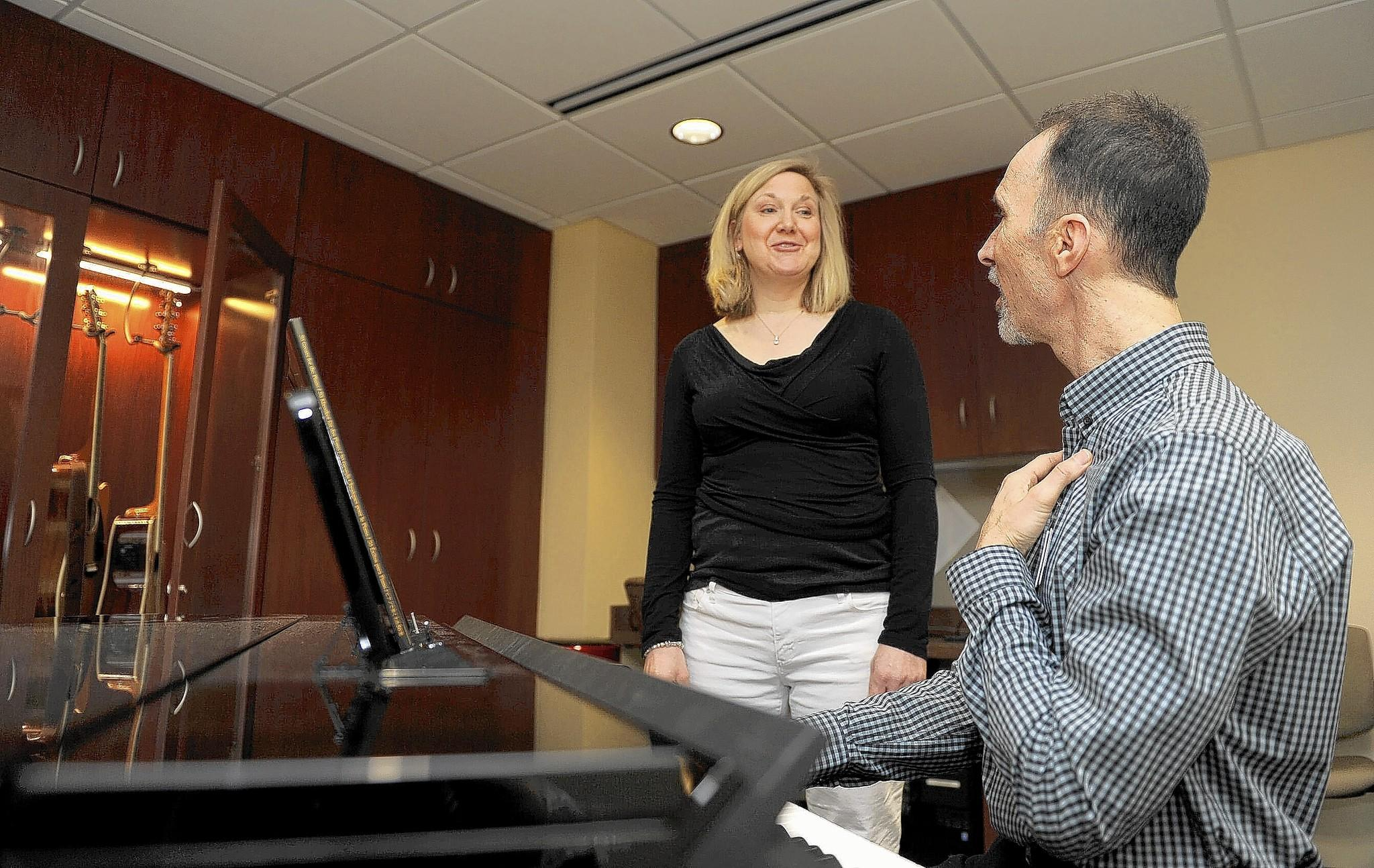 Vocal therapist Daniel Sherwood works with patient Teresa Wenck at the Johns Hopkins Voice Center's new Fender Music and Voice Studio, which is located on the GBMC campus.