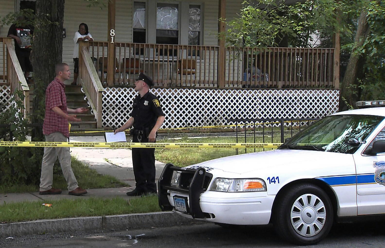 Hartford police investigate a shooting death near Jumoke Academy in Hartford's North End in July 2013. Neighborhood foot patrols can help community relations by putting police in closer contact with residents.