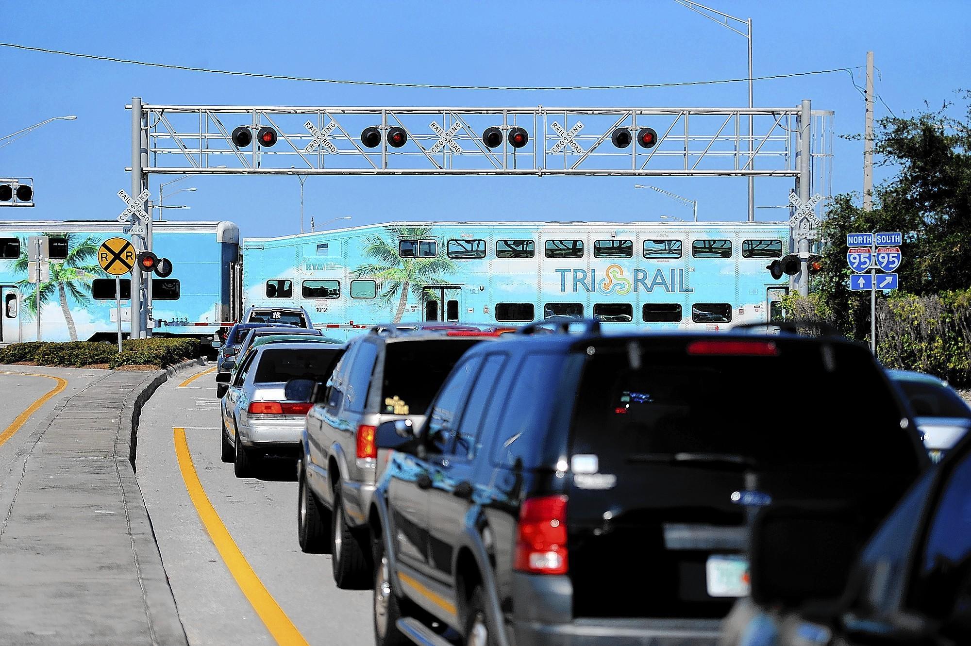 A Tri-Rail train roars south past Atlantic Avenue in Delray Beach.