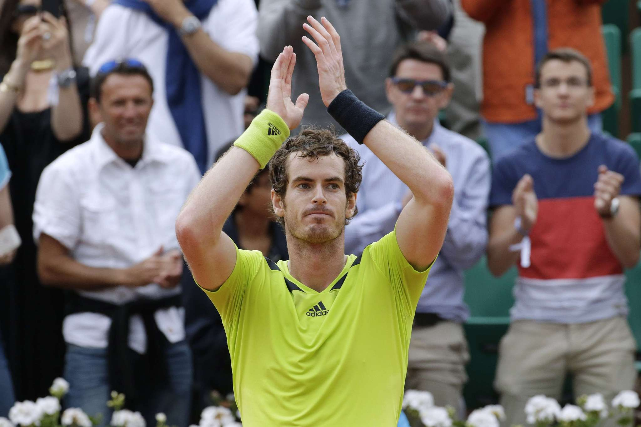 Andy Murray celebrates after winning his French tennis Open third-round match against Germany's Philipp Kohlschreiber.