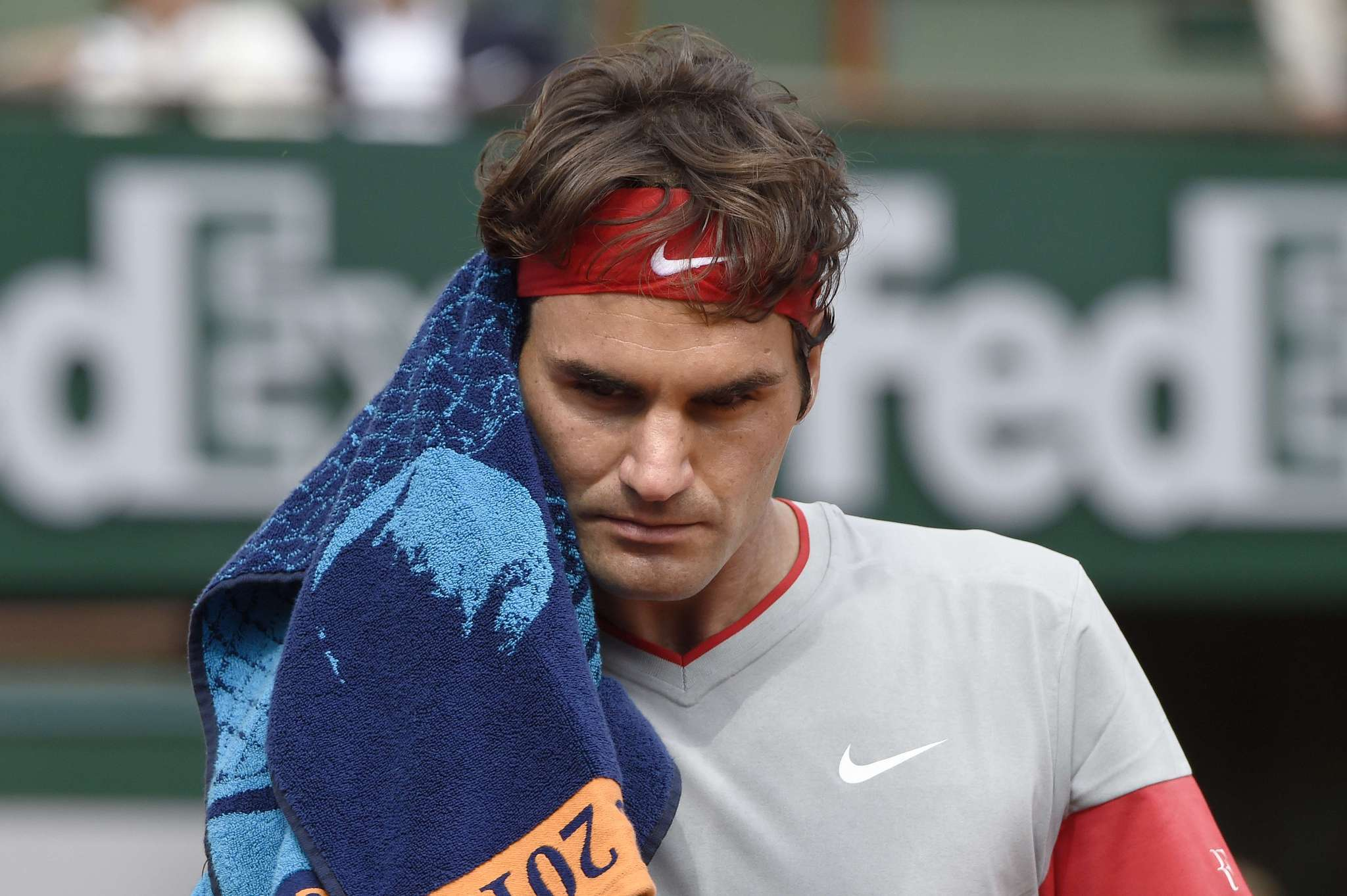 Roger Federer gestures during his French Open loss to Latvia's Ernests Gulbis.